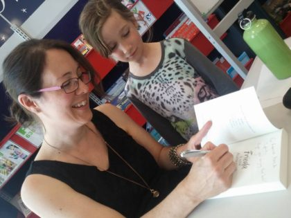 Marianne Musgrove signing a copy of Frieda with a young fan